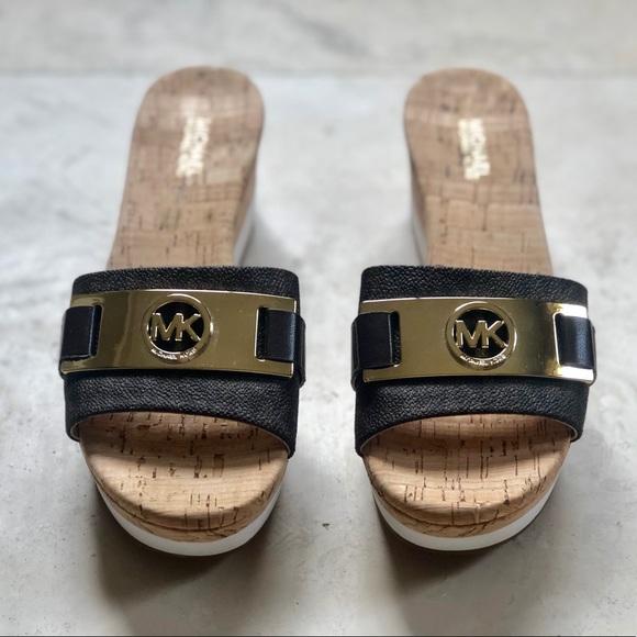 640d2c9b01b Michael Kors Warren Platform Wedge Sandal. M 5c3e9f991b32940f81fa322a